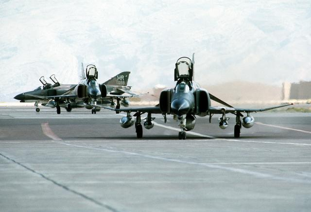 view of three F-4 Phantom II aircraft parked at Shiraz Air Base during exercise Cento. (August 1, 1977)