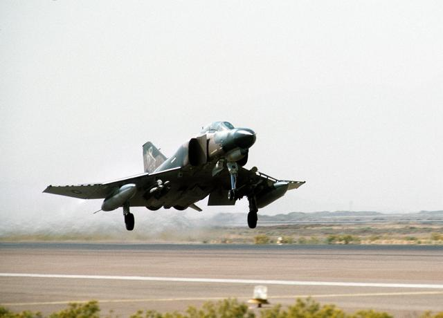A right front view of an F-4 Phantom II aircraft taking off from Shiraz Air Base during exercise Cento. (August 1, 1977)