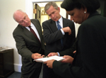 President George W. Bush and Vice President Dick Cheney and National Security Adviser Condoleezza Rice in the Outer Oval Office of the White House - WH Photo September 12, 2001