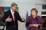 German Chancellor Angela Merkel and U.S. Secretary of State John Kerry in Berlin, February 26, 2013 - USDOS Photo