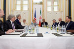 Secretary Kerry Listens as Iranian Foreign Minister Zarif Addresses Reporters Before Meeting in Austria for Latest Round of Nuclear Negotiations - USDOS Photo (June 27, 2015)