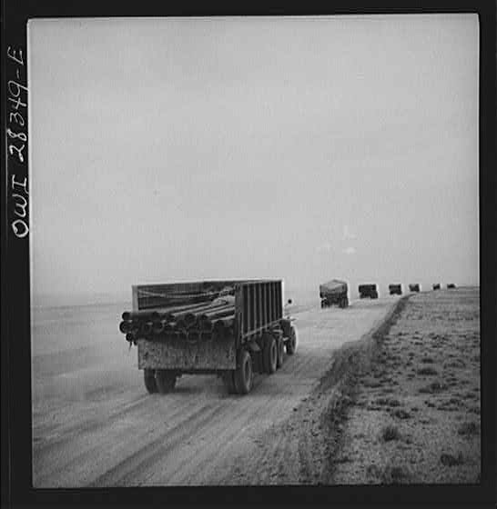 Somewhere in the Persian corridor. A United States Army truck convoy carrying supplies for Russia moving on a desert road.