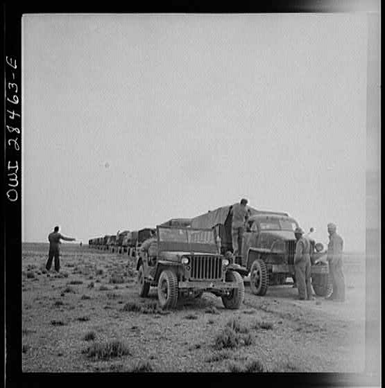 Somewhere in the Persian corridor. A United States Army truck convoy carrying supplies for Russia making a rest stop in the desert.