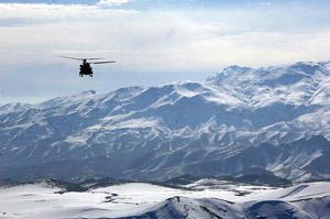 CH-47 Chinook helicopters flying over the Eastern Afghanistan Mountains - DOD