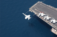 An F/A-18C over USS George Washington - Courtesy of US Navy