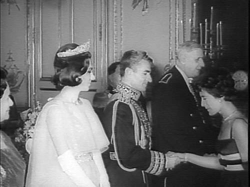 Shah of Iran & Empress Farah meeting dignitaries; French President Charles De Gaulle